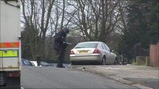 Army technical officers dealing with one of the suspect devices