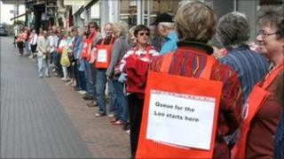 Campaigners queue for the loo in Broseley High Street, Shropshire.
