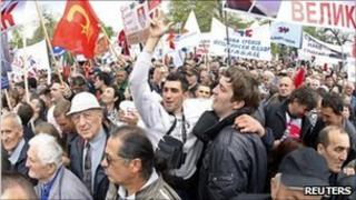 Supporters of Serbia's opposition Progressive Party hold flags and banners during a protest in Belgrade April 16, 2011