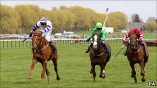 Beshabar ridden by Richard Johnson (left) went on to win from Merigo (centre)