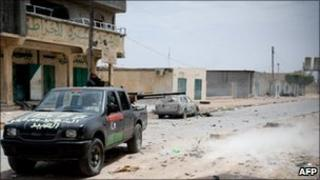 Rebel fighters attack a position occupied by government snipers in Misrata, Libya, 16 April 2011