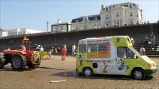 Ice cream van and tractor on beach