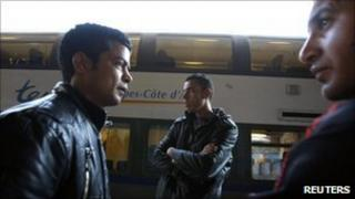 North African migrants wait at the train station in Ventimiglia, Italy (18 April 2011)