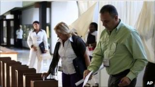 Delegates cast their votes during the Congress of the Cuban Communist Party session in Havana