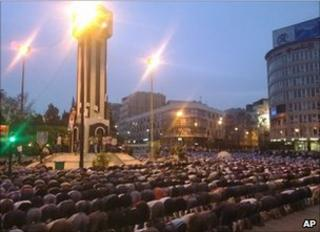 Syrians pray in Clock Square in Homs, 18 April (citizen journalism image)