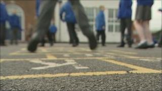 Children playing hopscotch at school