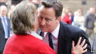 David Cameron kisses Annabel Goldie