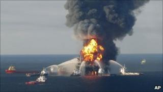 Fire boats spray water on to the Deepwater Horizon oil rig, which burned in the Gulf of Mexico last year