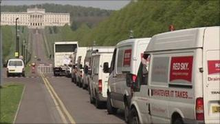 Red Sky vehicles in a convoy at Stormont