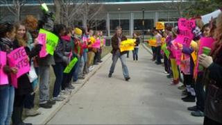 Students holding political signs