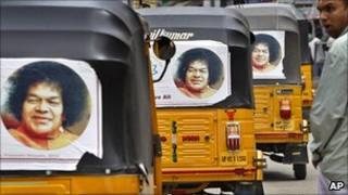 Rickshaws with pictures of Satya Sai Baba, in Puttaparti, India, April 2011