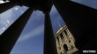 The Bank of England seen between pillars in the City of London