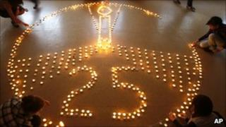 Pupils and teachers of the ecological gymnasium light candles to commemorate victims of the Chernobyl nuclear disaster in Minsk, Belarus, Monday, April 25, 2011.