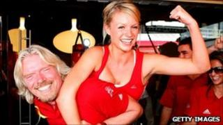 Sir Richard Branson and woman at the launch of a Virgin Active gym in Australia