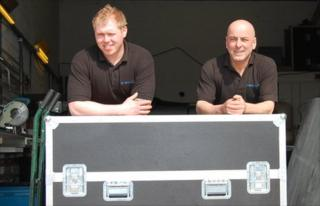 Daniel Henderson (left) and Gary Irons lean against one of their newly manufactured flight cases