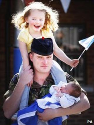 Fusilier Kristofer Crawford with his daughter Hannah, 3, and son, two-week-old Dominic, in Penicuik