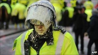 A policeman covered in paint at the demonstration on 9 December