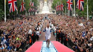 Steve Redgrave runs up the mall with the Athens Olympic torch in 2004