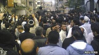 Anti-government protesters in the Syrian city of Homs