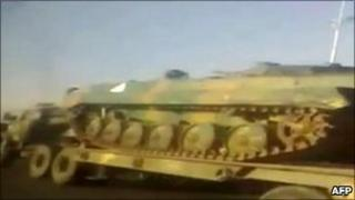 A video grab reportedly showing an army lorry transporting a tank near the flashpoint town of Deraa, Syria, 27 April 2011