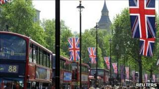 Crowds walk along Whitehall which will be part of the Royal Wedding Procession Route