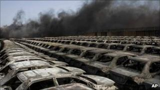 Newly imported cars hit in the fighting between rebels and pro-Gaddafi forces in the Libyan port city of Misrata on Wednesday
