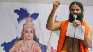 Indian yoga guru Ramdev speaks as he shows support to the hunger strike by 73-year-old Indian activist Anna Hazare in New Delhi, India, Friday, April 8, 2011