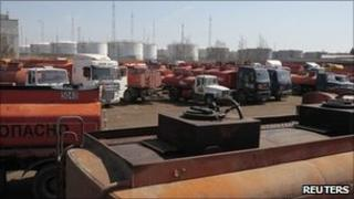Empty petrol tankers wait to fill up outside Moscow, 27 April