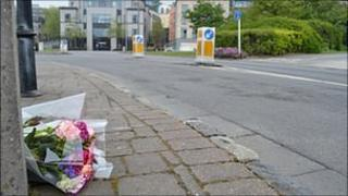 Flowers laid at the scene of the death of cyclist at the entrance to the North Beach Car Park