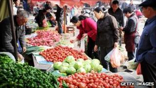 People shop for food in a fresh food market in east China.