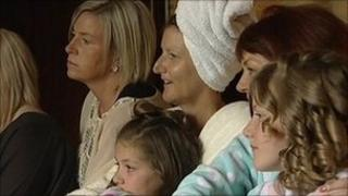 Caroline Chadwick (with the towel) watches the Royal Wedding with her family