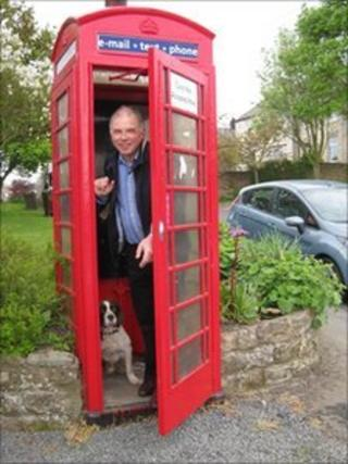 Parish Councillor Andrew Mate in the telephone box