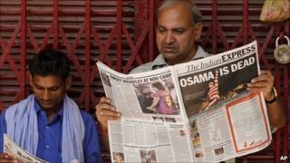 Indian man reads a newspaper