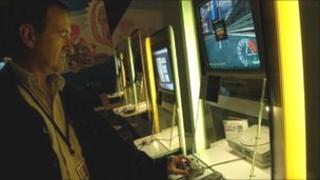 man looks at computer game generic