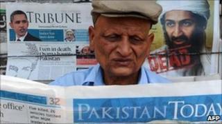 Pakistani man reads news of Bin Laden's death in paper