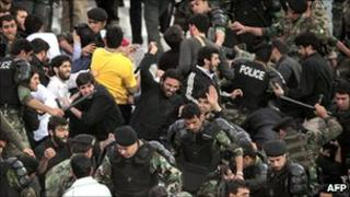 Iranian police expel anti-Saudi protesters during a during a football match, in Tehran, 3 May 2011