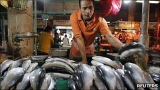 A vendor selling fish in Manila