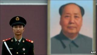 Chinese paramilitary policeman stands in front of picture of Mao Zedong in Tiananmen Square (file image)