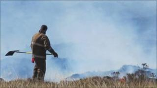 Firefighter beating flames