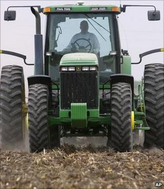 A tractor planting a corn field (Image: AP)