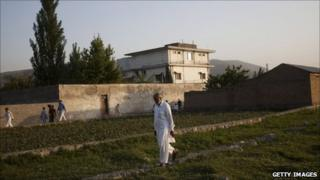 A man walks near the compound in Abbottabad where Osama Bin Laden was killed. File photo