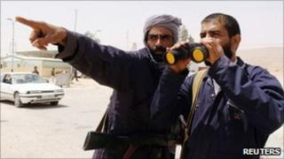Rebel fighters at the Libyan/Tunisian border crossing of Dehiba