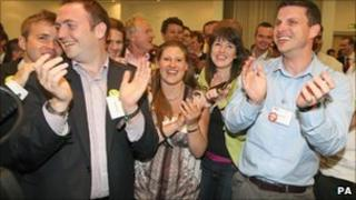 """Supporters of the """"No to AV"""" campaign celebrate at the London count for the national referendum on the alternative vote (AV) system at the Excel Centre, London."""