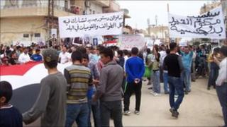 Syrian ethnic Kurds demonstrate after Friday prayers in the Syrian town of Qamishli