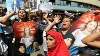 Egyptian Christians and Muslims protest in Cairo. 9 May 2011