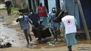 Red Cross workers remove corpses from Yopougon. 5 May 2011