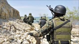 Mexican Navy marines conduct an operation in an island on Falcon Lake on 9 May 2011.