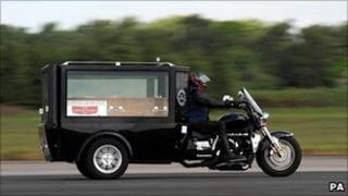Trike hearse at speed
