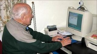 George Higgs using his computer on his 100th birthday