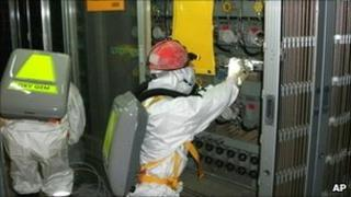 Workers check water level monitoring equipment inside reactor 1 at Fukushima Daiichi nuclear plant on 10 May 2011